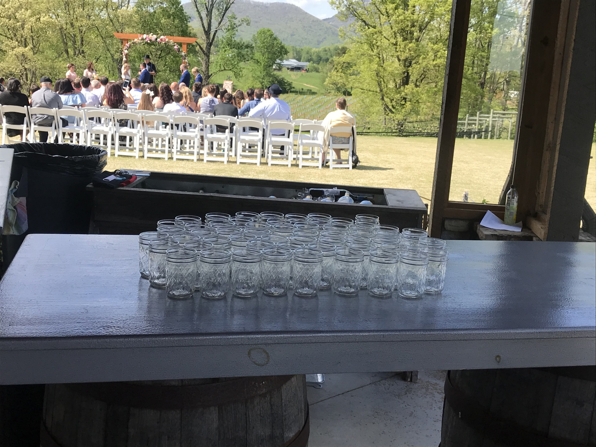 Bartender view of wedding at vineyard